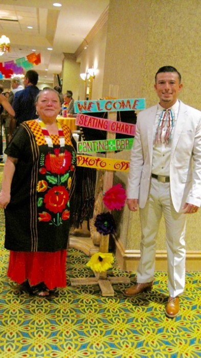 Laura Lopez, member of International Mexican Dinner Dance Committee, and her son, Alfred